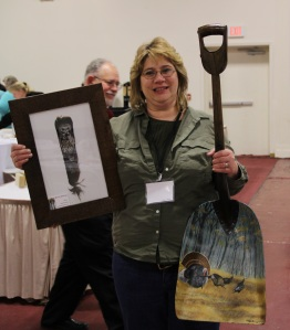 Darcy Foutch heading home with artwork by past NYS4-HSS Youth Artists of the Year, Brooke Thivierge and Molly Pokrzywka