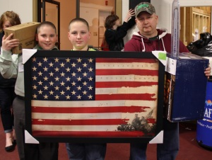 The Bushey Family from Essex County going home a great patriotic print and a Husquvarna Chainsaw