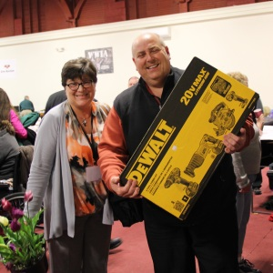 Karen & Tom Collins went home with spring flowers and a great Dewalt Power Tool Set