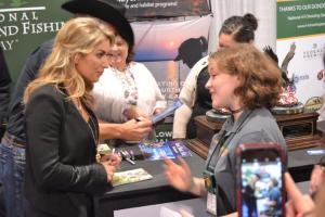 Role model for young shooters, Eva Shockey (L), talking with 4-H Teen Ambassador Logan Kimble-Lee (R) during the 2016 SHOT Show