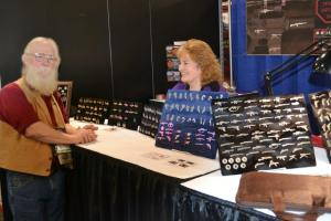 Education Specialist Kenyon Simpson (L) visiting with Michele Dougherty (R) of Empire Pewter