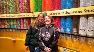 Colleen Kimble (L) and Logan Kimble-Lee (R) sharing a smile at the M&M store on Las Vegas Boulevard