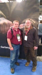 Assistant Director John Bowe with survival expert Dave Canterbury at the Industrial Revolution booth . IR produces the Light My Fire Brand.