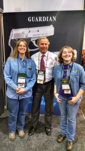 Colleen Kimble (L) and Logan Kimble-Lee (R) with Sandy Chisholm (C) owner of North American Arms - friend and supporter of 4-H Shooting Sports .