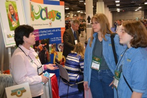 Lisa Muzzey (L), National 4-H Shooting Sports Committee meets with Colleen Kimble (C) and Logan Kimble-Lee (R) at the 2016 SHOT Show in Las Vegas, Nevada